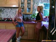 Lesbian sex in the kitchen